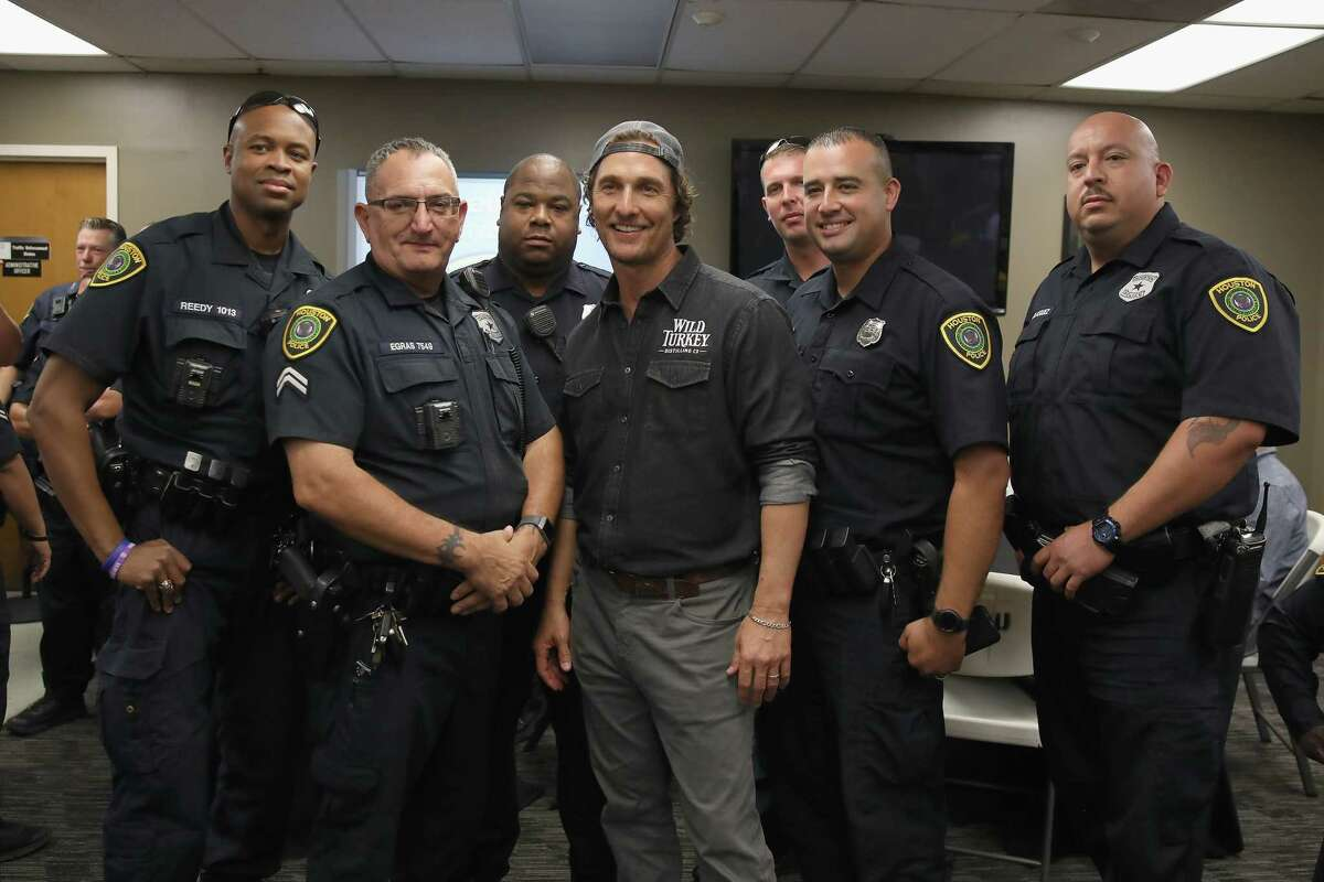 Matthew McConaughey takes photos with HPD officers during Wild Turkey gives back 2018.