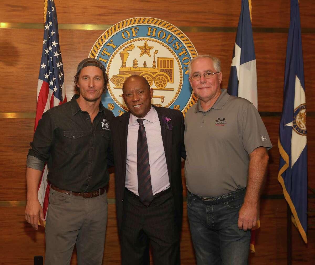 Matthew McConaughey, Mayor Sylvester Turner and Wild Turkey's Eddie Russell take photos during Wild Turkey gives back 2018.