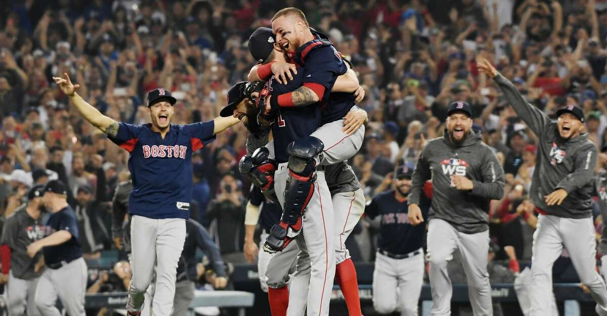 PHOTOS: The Red Sox celebrate their 2018 ALCS win over the Astros LOS ANGELES, CA - OCTOBER 28: Christian Vazquez #7 jumps into the arms of Chris Sale #41 of the Boston Red Sox to celebrate their 5-1 win over the Los Angeles Dodgers in Game Five to win the 2018 World Series at Dodger Stadium on October 28, 2018 in Los Angeles, California. (Photo by Harry How/Getty Images)