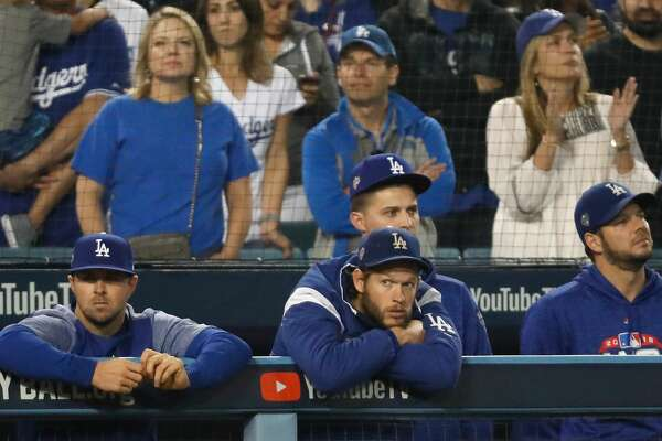 LOS ANGELES, CA - OCTOBER 28: Clayton Kershaw #22 of the Los Angeles Dodgers looks on from the dugout against the Boston Red Sox during the eighth inning in Game Five of the 2018 World Series at Dodger Stadium on October 28, 2018 in Los Angeles, California. (Photo by Sean M. Haffey/Getty Images)
