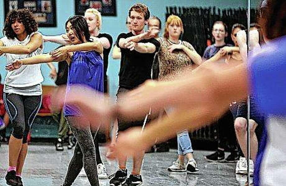 Hye Lim Cho (second from left), teaches hip/hop dance class in Decatur. The popular Korean music scene, K-pop, has made its way to the region and dance students have the opportunity to learn from a professional instructor. Photo: Clay Jackson | Herald & Review (AP)