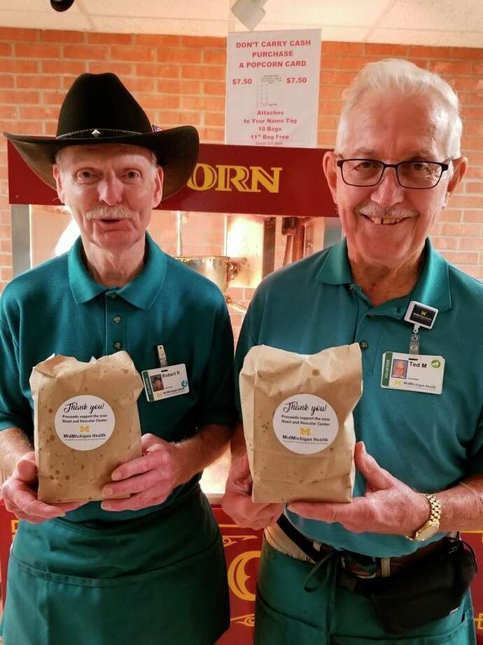 Heart patients will benefit from the sales of popcorn thanks to a $5,000 pledge from the Popcorn Service at MidMichigan Medical Center - Midland to the MidMichigan Health Foundation. Holding the freshly popped bags are Popcorn Service Volunteer Robert 'Cowboy Bob' Reid and Ted Mudd, chair of the Popcorn Service. Sales of popcorn will go toward the construction of a premier Heart and Vascular Center on the campus of MidMichigan Medical Center - Midland. (Photo provided)