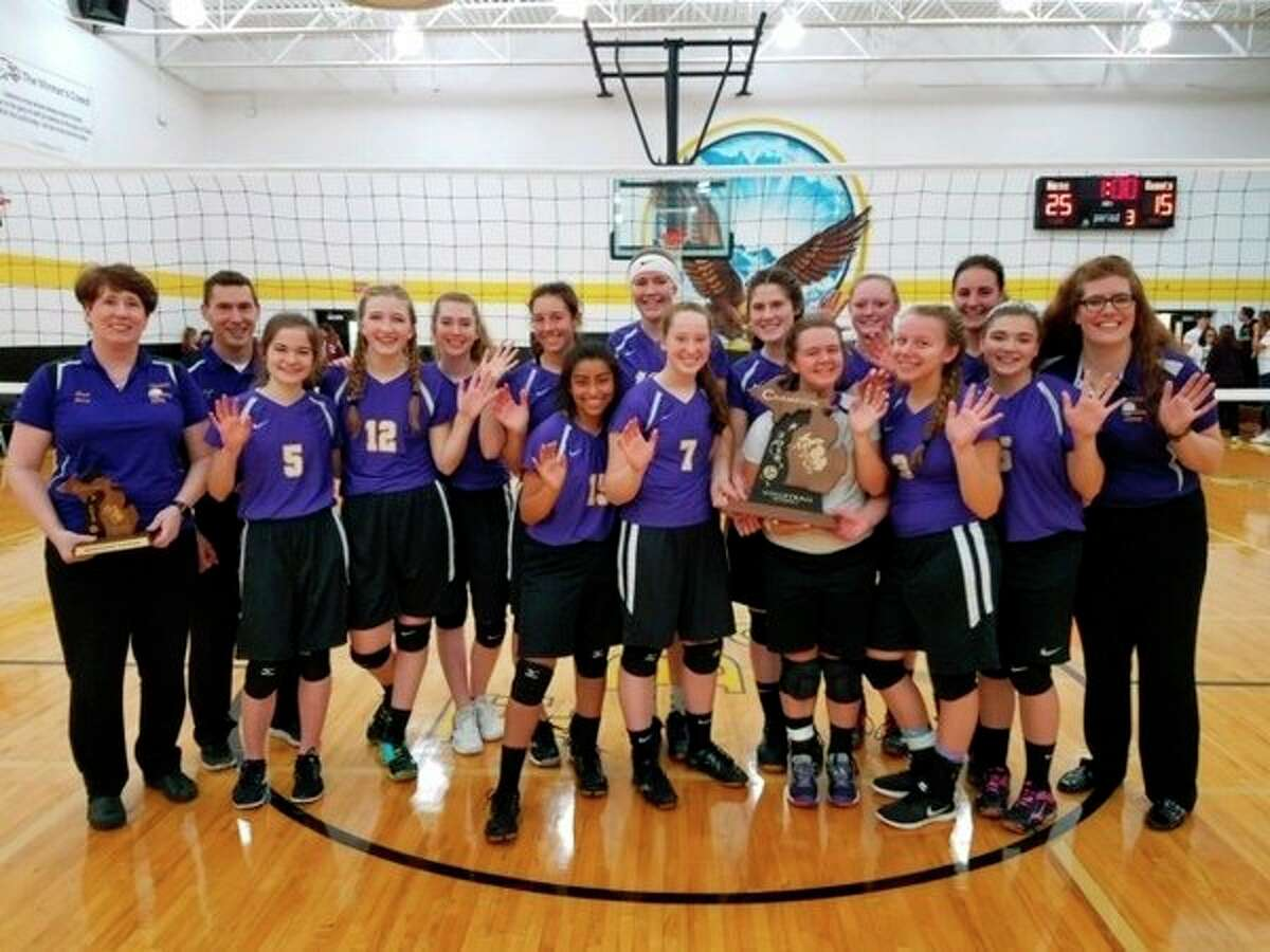 The Calvary Baptist volleyball team celebrates its fifth straight MACS state title on Saturday. (Photo provided)