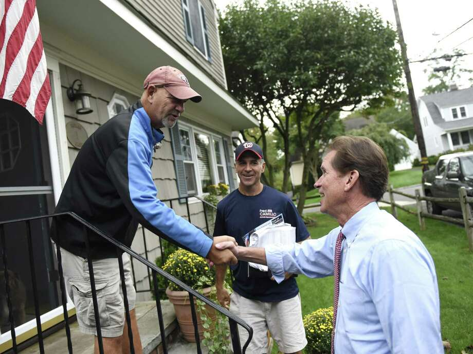 State Sen. L. Scott Frantz, R-Greenwich, shakes hands with Rick Capalbo while canvassing with state Rep. Fred Camillo, R-Greenwich, in the Cos Cob section of Greenwich, Conn. Tuesday, Oct. 9, 2018. Photo: Tyler Sizemore / Hearst Connecticut Media / Greenwich Time