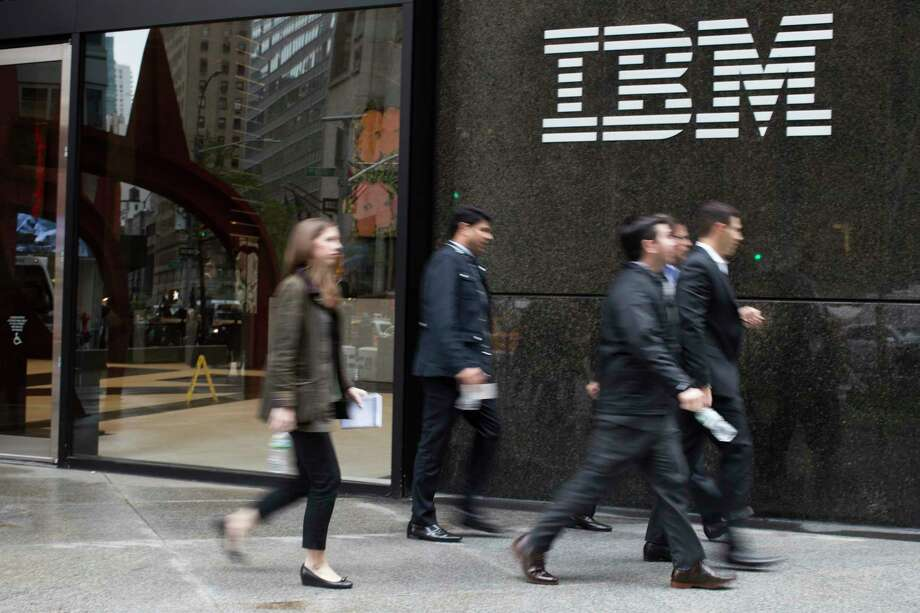 FILE- In this April 26, 2017, file photo, pedestrians walk past the IBM logo displayed on the IBM building in New York. Shares of Red Hat skyrocketed at the opening bell Monday, Oct. 29, 2018, after IBM, in the biggest acquisition in its 100-year history, acquired the software company. Photo: Mary Altaffer, AP / Copyright 2018 The Associated Press. All rights reserved.