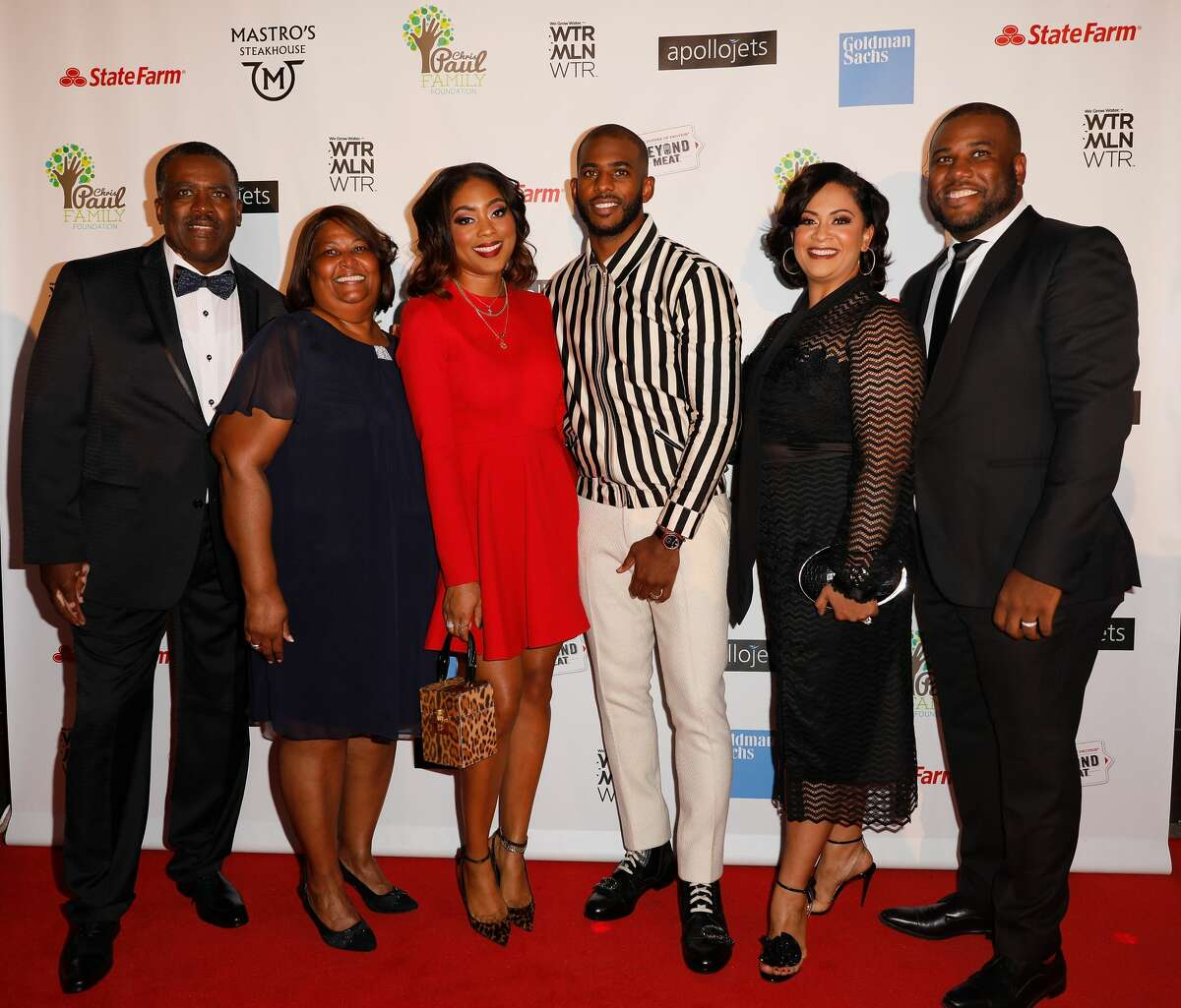 """HOUSTON, TX - OCTOBER 28: (L-R) Charles Paul, Robin Paul, Jada Crawley, Chris Paul, Desiree Paul and CJ Paul arrive at the Chris Paul Family Foundation's """"Celebrity Server"""" Fundraiser at Mastro's Steakhouse on October 28, 2018 in Houston, Texas. (Photo by Bob Levey/Getty Images)"""