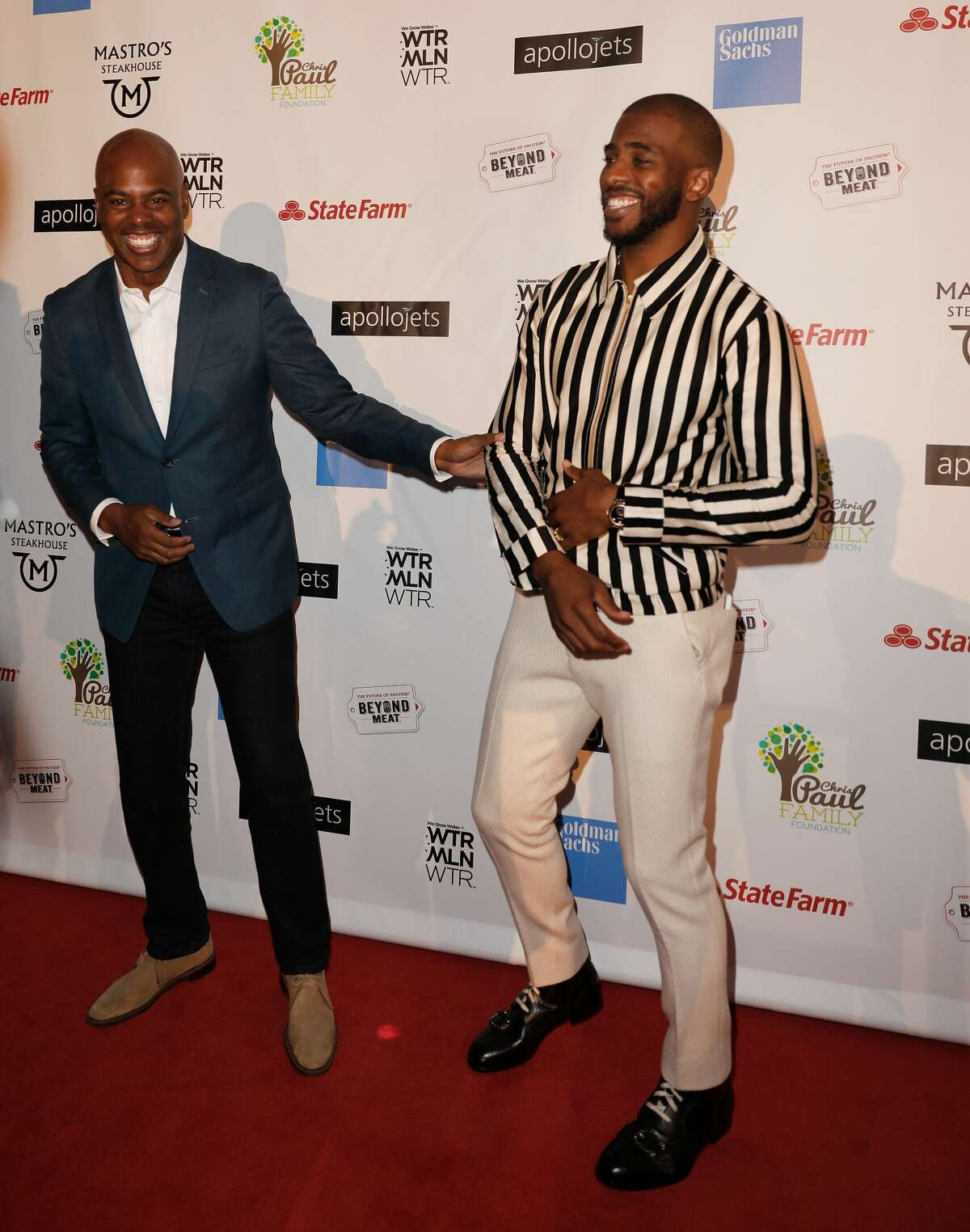 """HOUSTON, TX - OCTOBER 28: Kevin Frazier and Chris Paul at the Chris Paul Family Foundation's """"Celebrity Server"""" Fundraiser at Mastro's Steakhouse on October 28, 2018 in Houston, Texas. (Photo by Bob Levey/Getty Images)"""