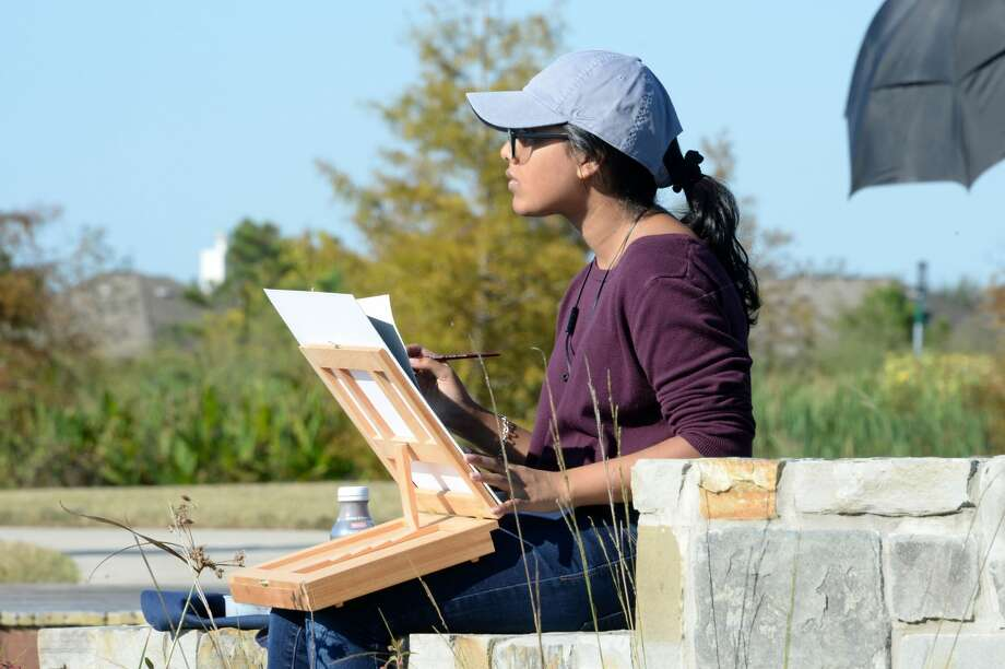 Simron Piswas of Seven Lakes High School works on her entry for the Plein Air Painting Competition at Willow Fork Park, Katy, TX on Saturday, October 27, 2018. Photo: Craig Moseley/Staff Photographer