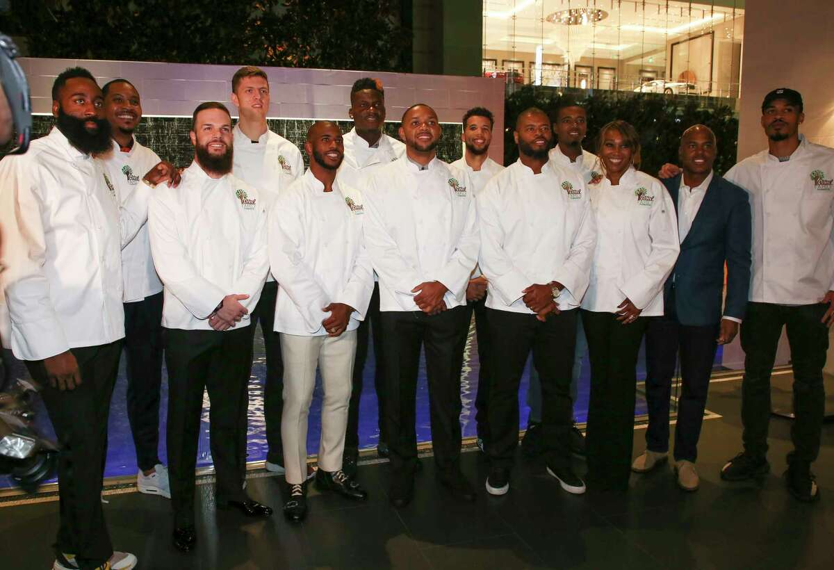 The servers for the evening pose for a photograph moments before the start of the 2018 Chris Paul Family Foundation's