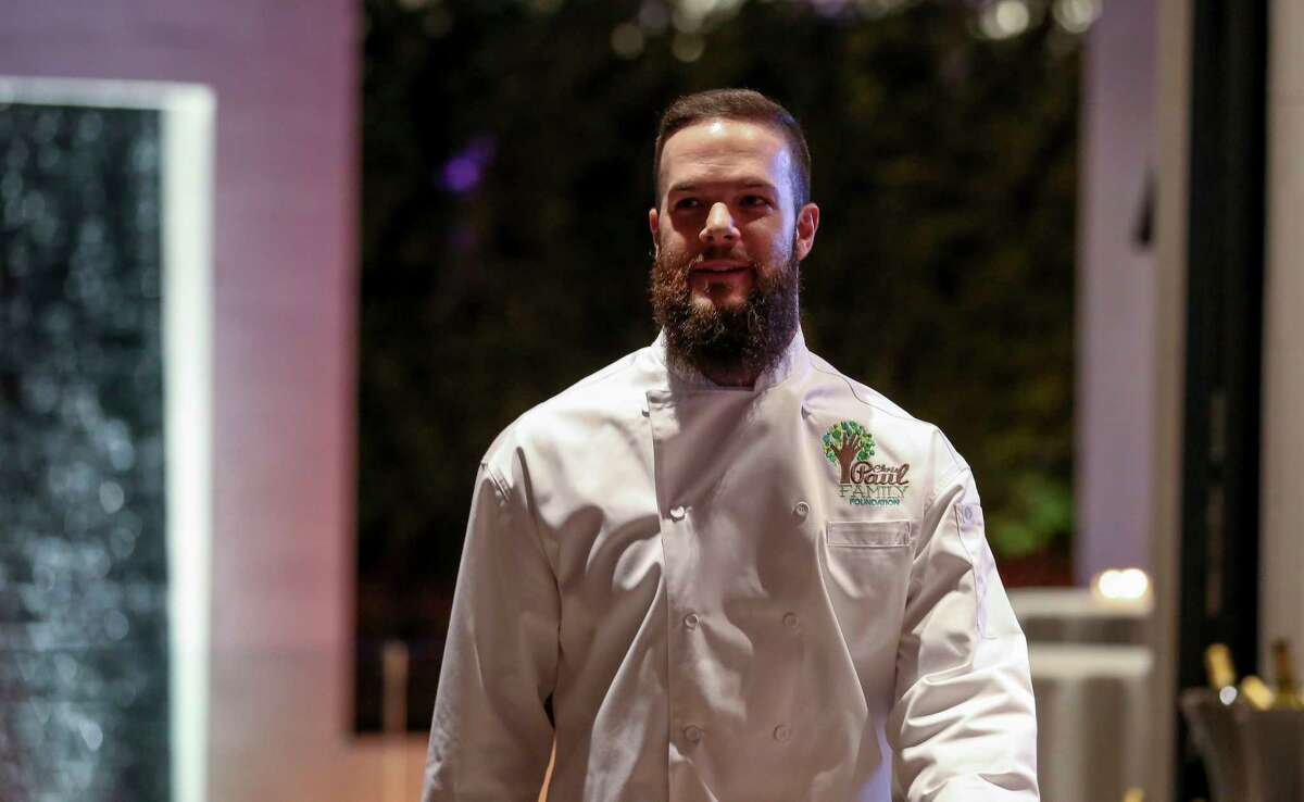 Houston Astros pitcher Dallas Keuchel is introduced as one of the servers at the 2018 Chris Paul Family Foundation's