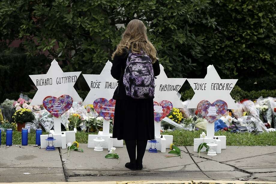 A person stands in front of Stars of David that are displayed in front of the Tree of Life Synagogue with the names of those killed in Saturday's deadly shooting in Pittsburgh, Monday, Oct. 29, 2018. (AP Photo/Matt Rourke) Photo: Matt Rourke, Associated Press