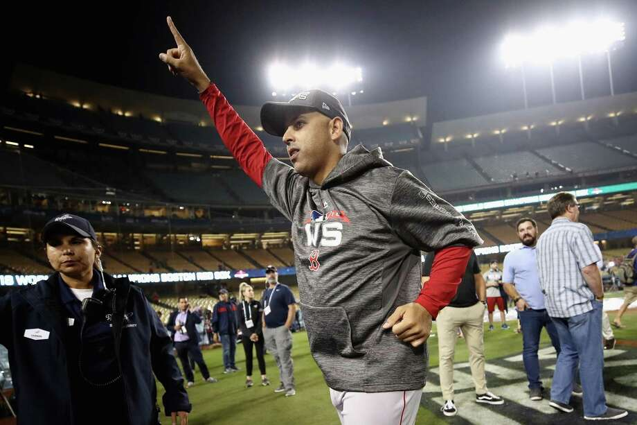 Alex Cora of the Boston Red Sox celebrates his teams 5-1 win over the Los Angeles Dodgers in Game Five of the 2018 World Series at Dodger Stadium on October 28, 2018 in Los Angeles, California. Photo: Ezra Shaw, Staff / Getty Images / 2018 Getty Images