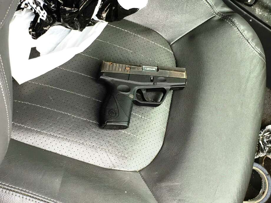 Ruben Medina, 21, of Stamford, and the 9 milometer pistol that police say he stashed in a car on Spruce Street over the summer. Photo: Stamford Police / Contributed