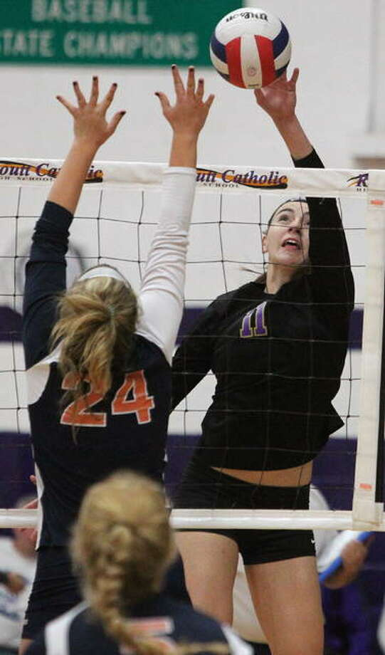 Routt's Annika Black tips the ball during a recent match against New Berlin. Photo: Dennis Mathes | Journal-Courier