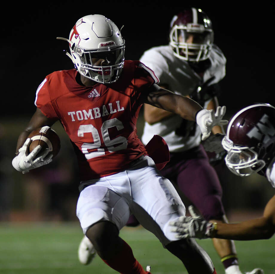 Tomball senior running back Daveon Vean (26) pushes for yardage against a Waller defender in the 3rd quarter of their district matchup at Cougar Stadium in Tomball on Oct. 12, 2018. Photo: Jerry Baker, Contributor / Houston Chronicle