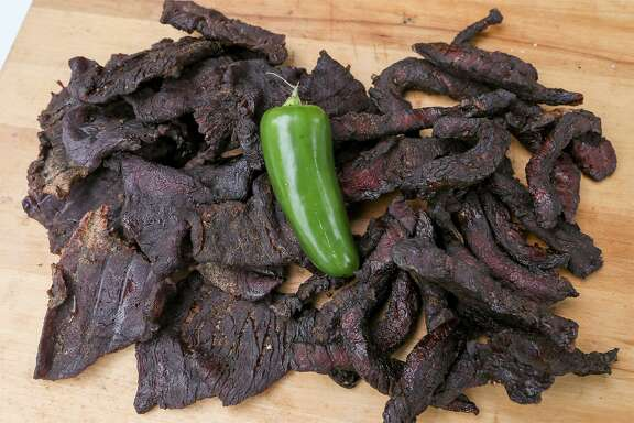 Jalapeño Honey Beef Jerky made from slices of eye of round steak, left, and Smoked Paleo Beef Jerky from strips of flank steak fresh off the smoker at Chuck's Food Shack.