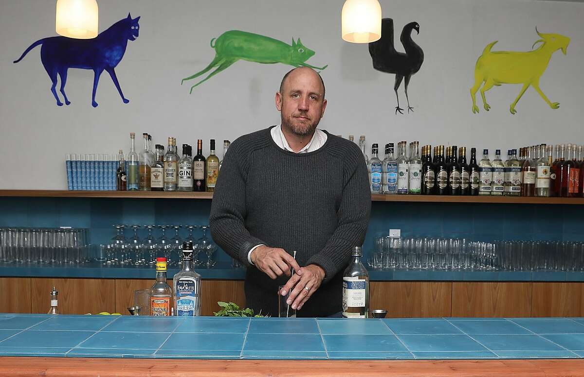 Bar owner Thad Vogler makes a Mojito at Obispo, a rum bar in the Mission, on Thursday, Oct. 25, 2018 in San Francisco, Calif. Behind him is art seen from Bill Traylor on the walls.