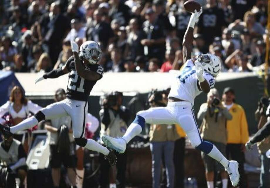 Indianapolis Colts tight end Mo Alie-Cox (81) catches a pass for a touchdown against Oakland Raiders cornerback Gareon Conley (21) during the first half of an NFL football game in Oakland, Calif., Sunday, Oct. 28, 2018. (AP Photo/Ben Margot) Photo: Ben Margot / Associated Press