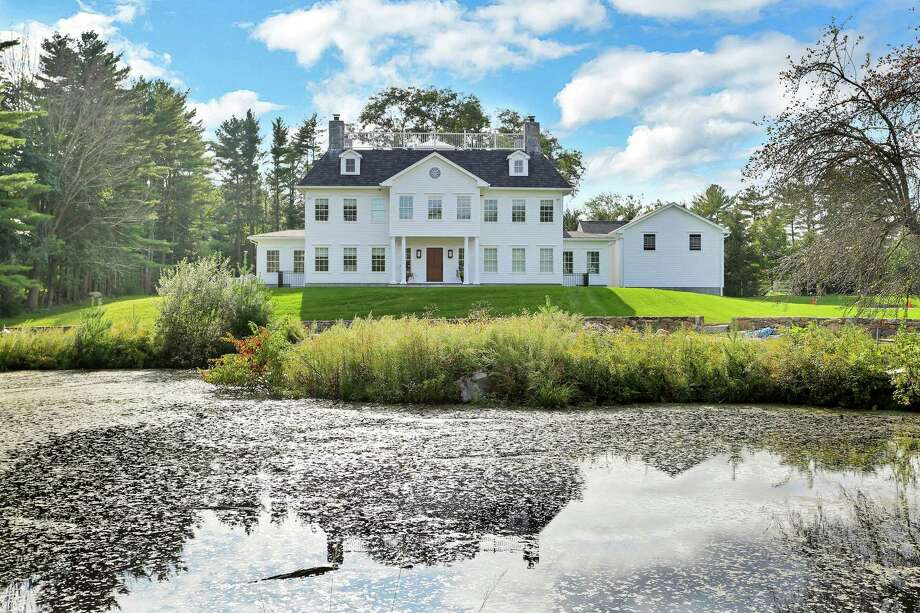 This 2018-built, six-bedroom colonial at 427 Taconic Road has 6,504 square feet of living space, with formal living and dining rooms. Photo: Houlihan Lawrence / ONLINE_CHECK