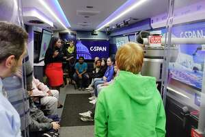 """Troy Middle School students take a tour of the C-SPAN Bus, parked outside their school on Monday, Oct. 29, 2018, in Troy, N.Y. The bus is in the Capital Region Monday and Tuesday as part of the C-SPAN's """"50 Capitals Tour"""". The bus will be at the Empire State Plaza outside the capitol building in downtown Albany on Tuesday morning until 12:30pm.   (Paul Buckowski/Times Union)"""