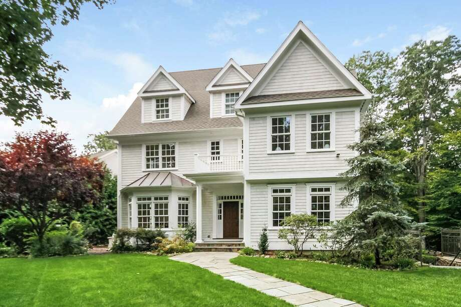 The shingle-style five-bedroom colonial at 28 Briar St. in Rowayton is on 0.48 acres with an in-ground pool and spa. Photo: PlanOmatic / © 2018 PlanOmatic
