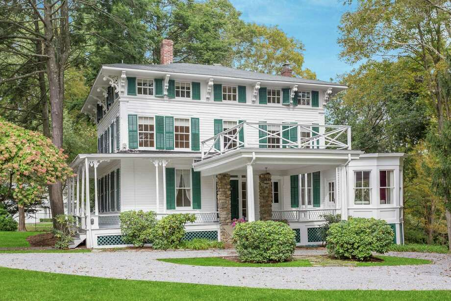 The six-bedroom 1845 Hanford-Hull-Bell House is a historic New Canaan landmark. The three-story Italianate villa is on 1.8 acres with a large flat yard with mature rhododendrons and trees and a bucolic pond. It is listed for $1.4 million. Photo: William Pitt Sotheby's International Realty / ONLINE_CHECK