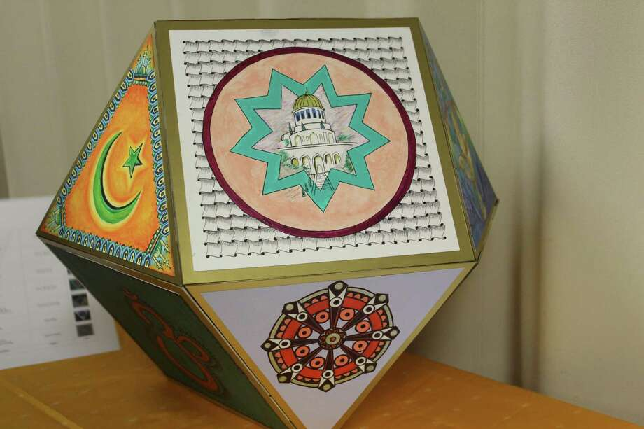 The FaithsTogether group is hosting their 20th Giving Observance Nov. 13 at 7 p.m. at The Woodlands Community Presbyterian Church along West Panther Creek Drive. This year, the faith groups have collaborated on an art project to display at the event. It's a 3D geometric polygon with 14 sides, and each side holds an illustrated panel from a different faith community. Photo: Jane Stueckemann/The Villager / Jane Stueckemann/The Villager