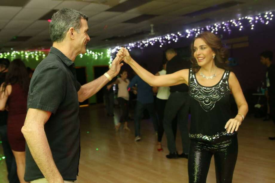 A dance couple enjoys their time on the dance floor at Dance Heights. In addition to classes, Dance Heights offers workshops and socials. Photo: Dance Heights