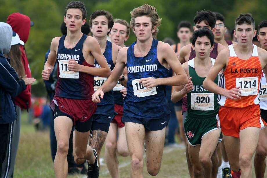 Kingwood senior Carter Storm, center, runs with Tompkins junior Cole Lindhorst, left, Strake Jesuit junior Erik Lara (920), and La Porte junior Ryan Schoppe (1214) during the Division 6A Boys race at the UIL Region III Cross Country Championships at Kate Barr-Ross Park in Huntsville on Oct. 22, 2018. Photo: Jerry Baker, Houston Chronicle / Contributor / Houston Chronicle