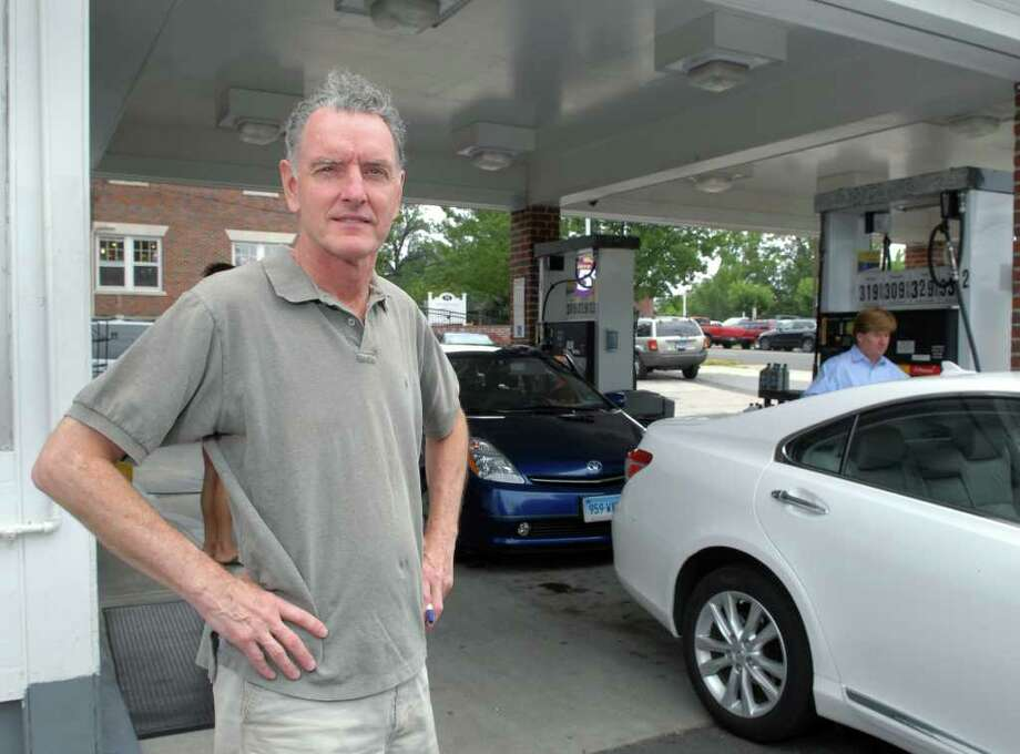 Chris Canavan posed in front of the Greenwich Shell gas station at 83 E. Putnam Ave., Greenwich, July 15, 2010.  Canavan is a part owner of the station. Photo: ST / Greenwich Time