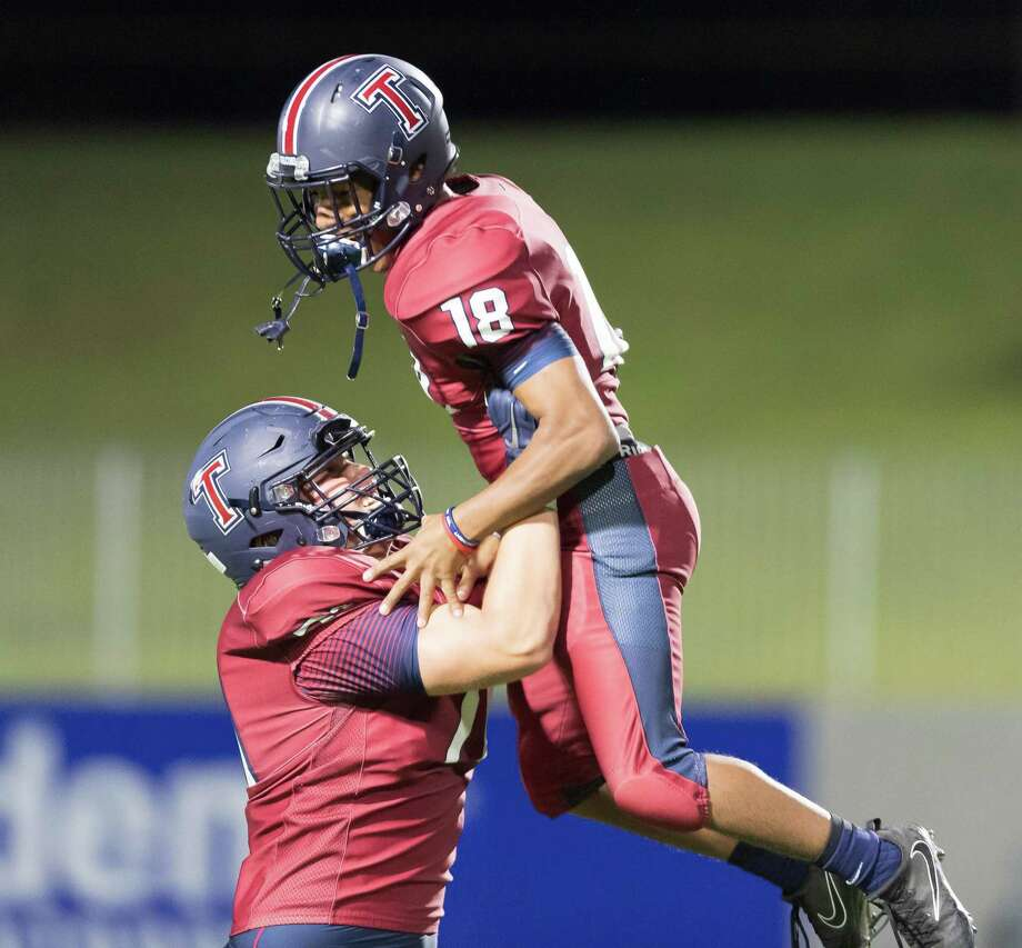 Dustin Bradley (18) of the Tompkins Falcons celebrates their win over the Taylor Mustangs with Rex Martin (71) in a high school football game on Thursday, October 25, 2018 at Legacy Stadium in Katy Texas. Photo: Wilf Thorne / Contributor / © 2018 Houston Chronicle
