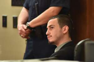 Jesse David Vasquez Jr listens during his sentencing trial Monday morning in the 187th District Court. Vasquez Jr. was convicted of the murder of his father.