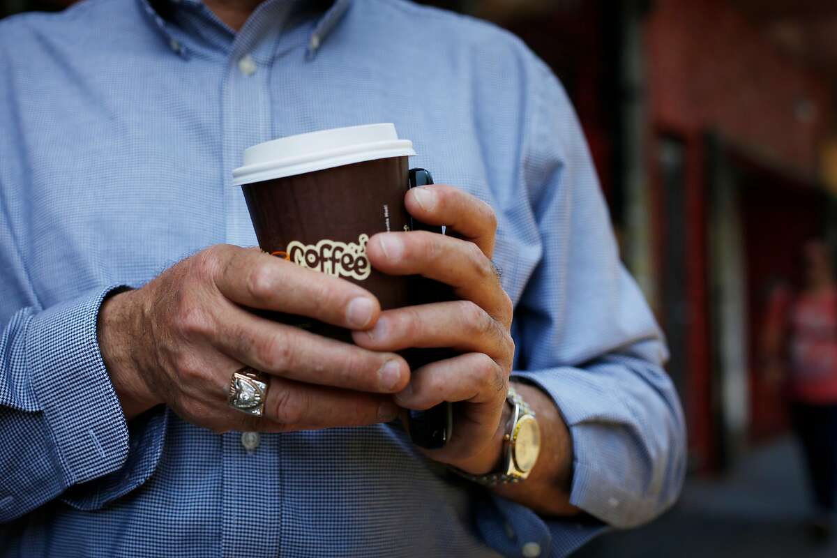 Founder and owner of Philz Coffee Phil Jaber holds his own cup of coffee at the corner of 24th and Folsom Streets on June 4, 2014 in San Francisco, Calif