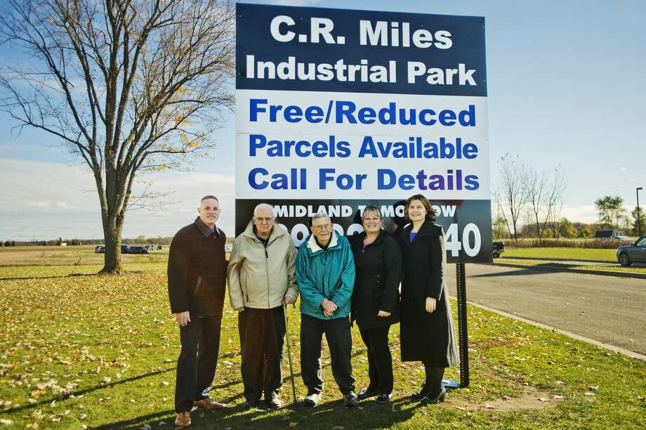 From left, Midland County Commissioner Mark Bone, Alan Ott, Cliff Miles, Midland Tomorrow President/COO Becky Church and Herbert H. and Grace A. Dow Foundation Executive Director Jenee Velasquez pose for a photo after a dedication ceremony for the C.R. Miles Industrial Park, named after Cliff Miles, on Monday, Oct. 29, 2018 in Coleman. (Katy Kildee/kkildee@mdn.net) Photo: (Katy Kildee/kkildee@mdn.net)
