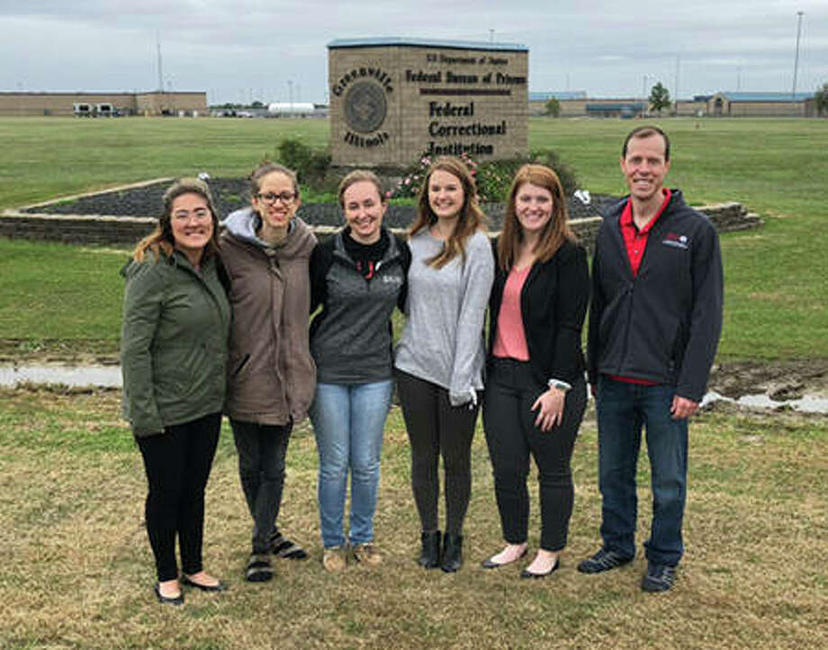 SIUE students visiting the Federal Corrections Institution in Greenville (L-R) Alex Mena, Erin Ryan, Kaitlin Henning, Lizzy Sakran, Amanda Raymond and Megan Mosley (not pictured). They stand alongside School of Education, Health and Human Behavior Interim Dean Paul Rose. Photo: For The Intelligencer
