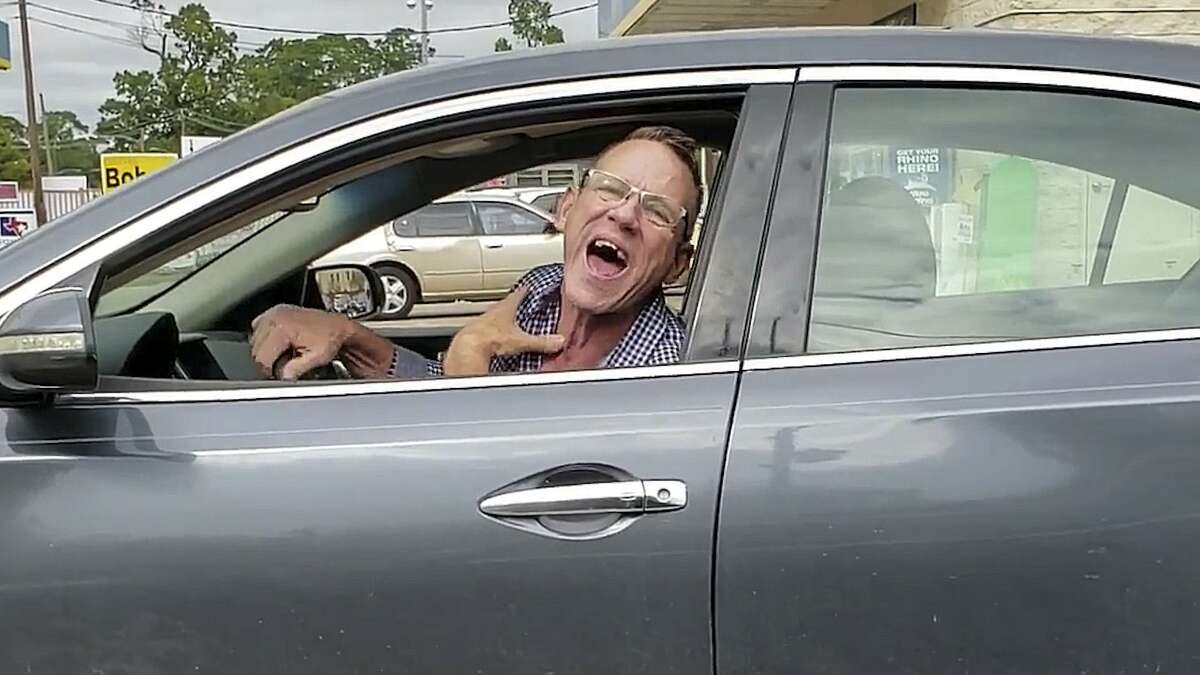"""The man caught on video that verbally attacked Mexican-American Janet Espejel with racial slurs while she was driving on Westview Drive, northwest of Houston, with her two-year-old daughter on Thursday, 25 of October. """"Trump is deporting your illegal cousins today... It's my country, b..ch, get out... you are ugly,"""" shouted the man, among other expletives. Still frame from video by Janet Espejel."""