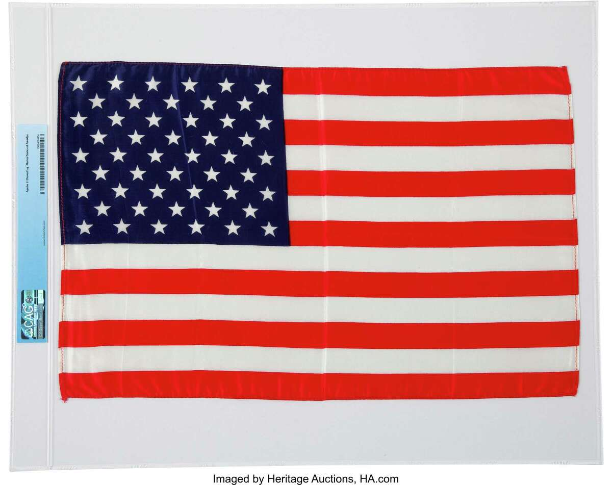 """This 17.75"""" x 11.5"""" silk U.S. flag with red stitching around the edges was carried to the moon with Apollo 11, the first manned lunar landing, in 1969. The flag is one of about 1,300 items from the personal collection of NASA astronaut Neil Armstrong, the first man on the moon, being auctioned off Thursday and Friday by Dallas-based Heritage Auctions."""