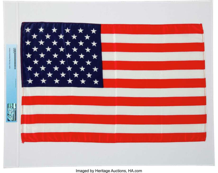 "This 17.75"" x 11.5"" silk U.S. flag with red stitching around the edges was carried to the moon with Apollo 11, the first manned lunar landing, in 1969. The flag is one of about 1,300 items from the personal collection of NASA astronaut Neil Armstrong, the first man on the moon, being auctioned off Thursday and Friday by Dallas-based Heritage Auctions. Photo: CREDIT: Heritage Auctions / CREDIT: Heritage Auctions"
