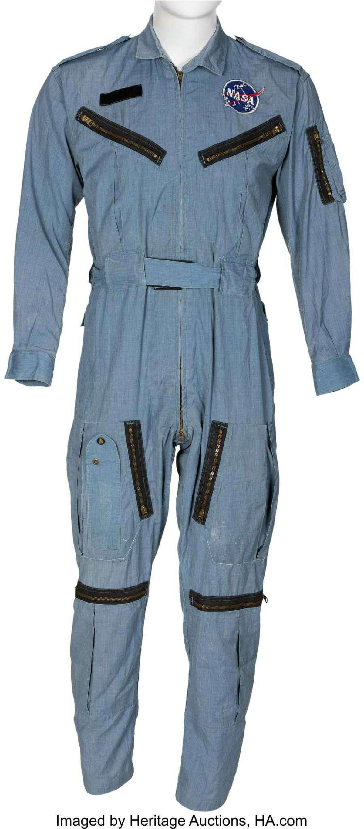 """A light blue cotton one-piece jumpsuit with an embroidered NASA """"meatball"""" vector patch at the left breast shows an empty Velcro strip at right for affixing a nametag. This suit was owned and worn by NASA astronaut Neil Armstrong, the first man on the moon, during the Gemini program, and was sold at auction recently by Dallas-based Heritage Auctions. Velcro was used widely by NASA but was not invented by the space agency."""