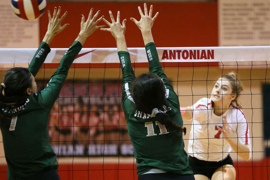 Antonian's Mia Carter (from right) gets a kill shot past Incarnate Word's Yesenia Perez and AnnaLysa Alba during their TAPPS 3-6A high school volleyball match at Antonian on Tuesday, Oct. 23, 2018. Photo: Marvin Pfeiffer / Staff Photographer / Express-News 2018