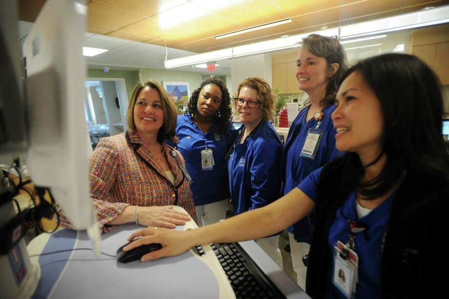 Bridgeport Hospital Senior Vice President and Chief Nursing Officer MaryEllen Hope Kosturko, left, meets with nurses in a medical surgical unit at the hospital in Bridgeport, Conn., on May 9, 2018. Photo: Brian A. Pounds / Hearst Connecticut Media / Connecticut Post