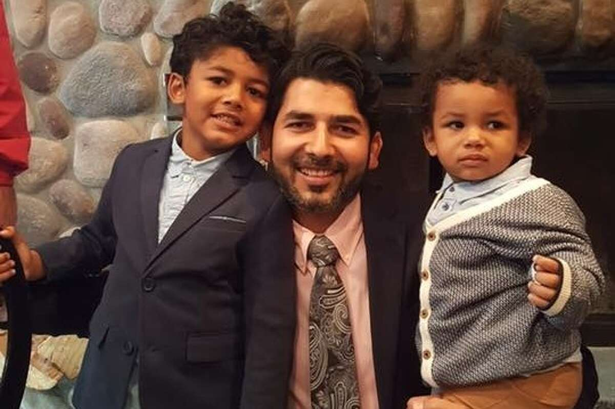 Manu Dutt, a Windham resident who has been in immigration detention for ten months, pictured with his two sons in an undated photo.