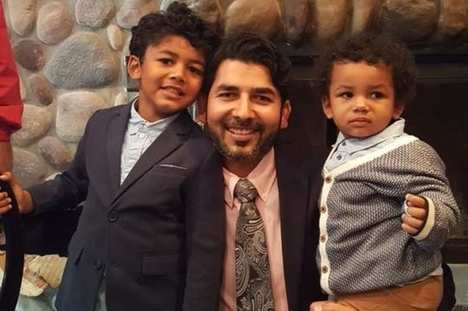 Manu Dutt, a Windham resident who has been in immigration detention for ten months, pictured with his two sons in an undated photo. Photo: Courtesy Of Shiv Sharma