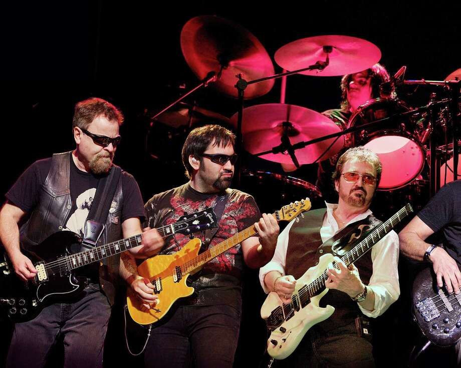 "Blue Oyster Cult's Eric Bloom, left, Richie Castellano, Donald ""Buck Dharma"" Roeser, and drummer Jules Radino play the Wall Street Theater in Norwalk on Halloween, Oct. 31. Bloom and Roeser are original members of the legendary rock band. Photo: Contributed Photo / Contributed Photo / Norwalk Hour contributed"