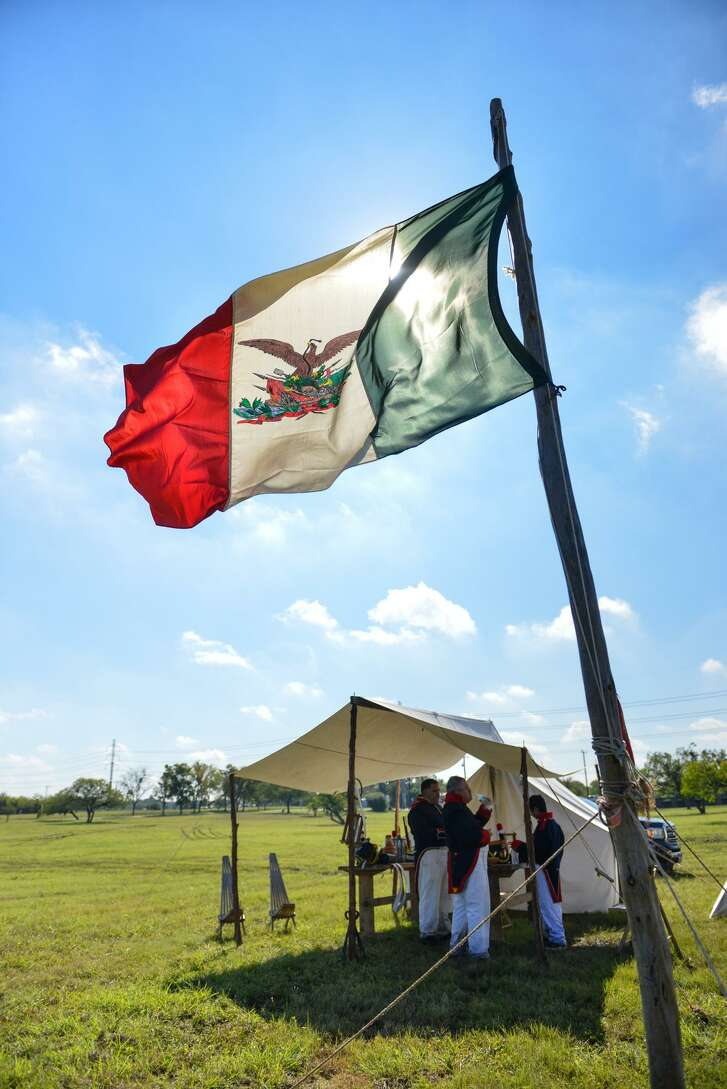 Mexican Army re-enactors take a break Saturday during the San Antonio Living History Association re-enactment of the two opening battles of the Texas Revolution in Kirby's Friendship Park.