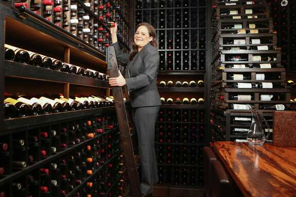 Vanessa Treviño Boyd, the sommelier at the Houstonian Hotel, Club & Spa, in the wine room of the new TRIBUTE restaurant (formerly Olivette).
