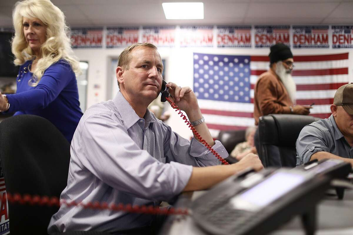 MODESTO, CA - OCTOBER 26: U.S. Rep. Jeff Denham of California's 10th Congressional District (LEFT C) makes a canvassing phone call at campaign headquarters on October 26, 2018 in Modesto, California. Democratic congressional candidate Josh Harder is competing for Republican Rep. Jeff Denham's seat in the upcoming midterms. Democrats are targeting at least six congressional seats in California, currently held by Republicans, where Hillary Clinton won in the 2016 presidential election. (Photo by Mario Tama/Getty Images)