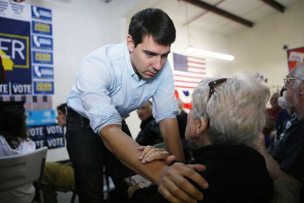 MODESTO, CA - OCTOBER 24: Democratic congressional candidate Josh Harder speaks to a supporter at a campaign rally in support of Social Security and Medicare on October 24, 2018 in Modesto, California. Harder is running for the seat held by incumbent U.S. Rep. Jeff Denham (R-CA). Democrats are targeting seven congressional seats in California, currently held by Republicans, where Hillary Clinton received more votes in the 2016 presidential election. These districts have become the centerpiece of their strategy to flip the House and represent nearly one-third of the 23 seats needed for the Democrats to take control of the chamber in the November 6 midterm elections. (Photo by Mario Tama/Getty Images)