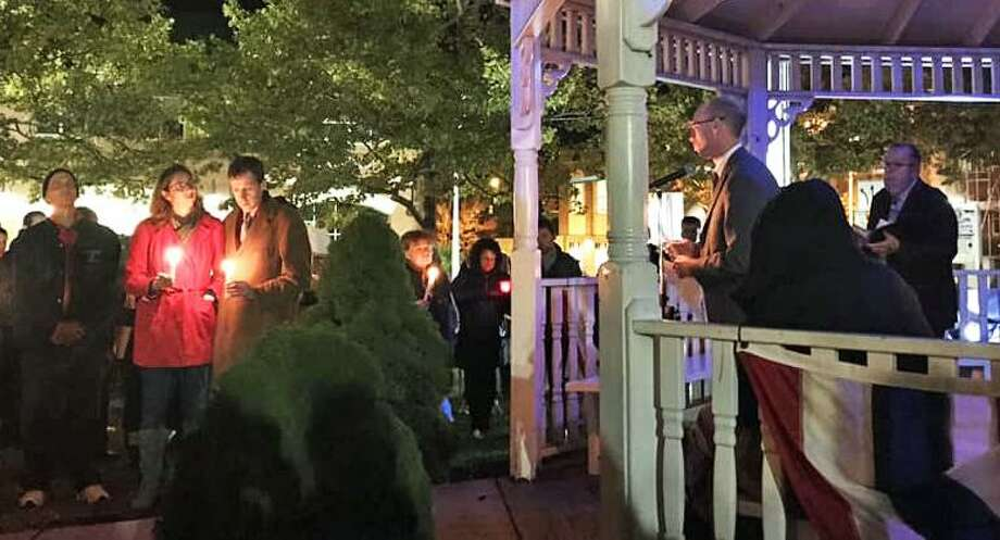 A couple hundred individuals of all faiths turned out Sunday night at Middletown's South Green to honor the 11 people killed during Saturday's shooting at the Tree of Life Synagogue in the Squirrel Hill section Pittsburgh, Pennsylvania. Six others were injured. Middletown resident, Attorney Sarah Steinfeld, in red, wife of state Rep. Matthew Lesser, D-Middletown, to her right, grew up in the neighborhood. Photo: Patti Anne Vassia Photo