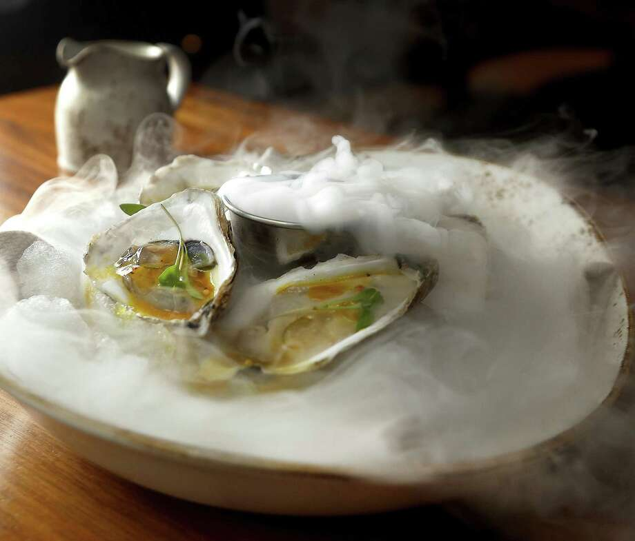Pearl Oysters with passion fruit curry and fine herbs at Main Kitchen in the JW Marriott Houston Downtown. Photo: Karen Warren, Houston Chronicle / Staff Photographer / © 2018 Houston Chronicle